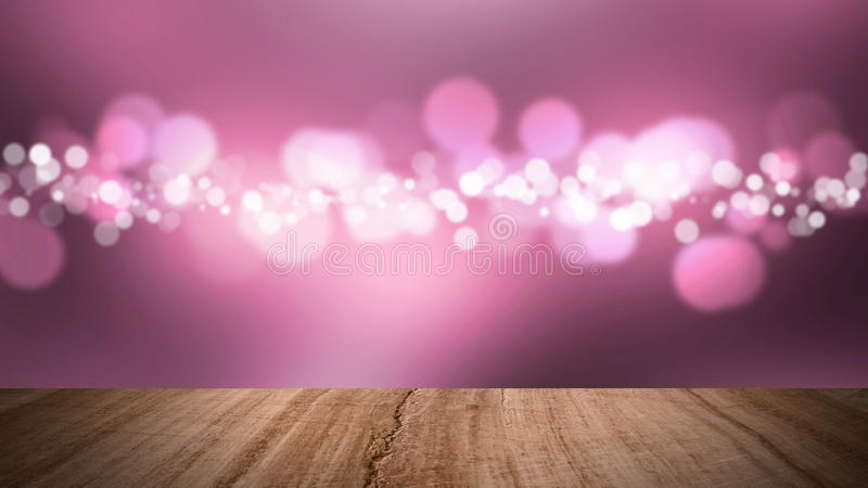 Wood floor and bokeh pink background. stock photography