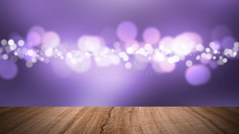 Wood floor and bokeh purple background. royalty free stock photos