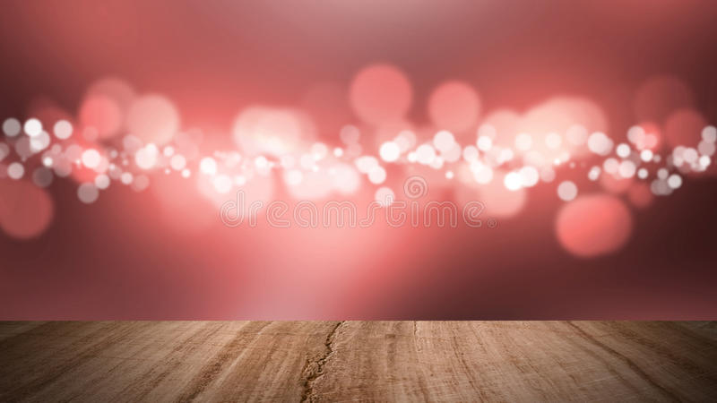Wood floor and bokeh red background. royalty free stock photos