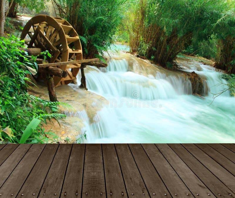 Wood floor perspective and natural mountain waterfall ,Tat Guangxi Waterfall, Luang Prabang. royalty free stock photos