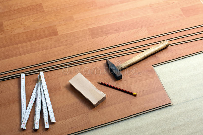 Wood flooring and tools. The wood flooring and tools royalty free stock images