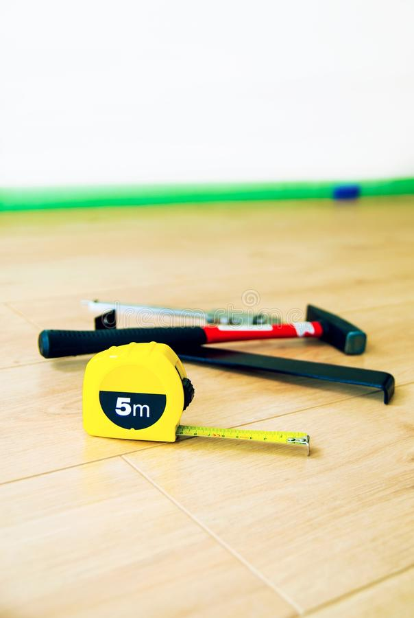 Wood flooring and tools. The wood flooring and tools royalty free stock photos