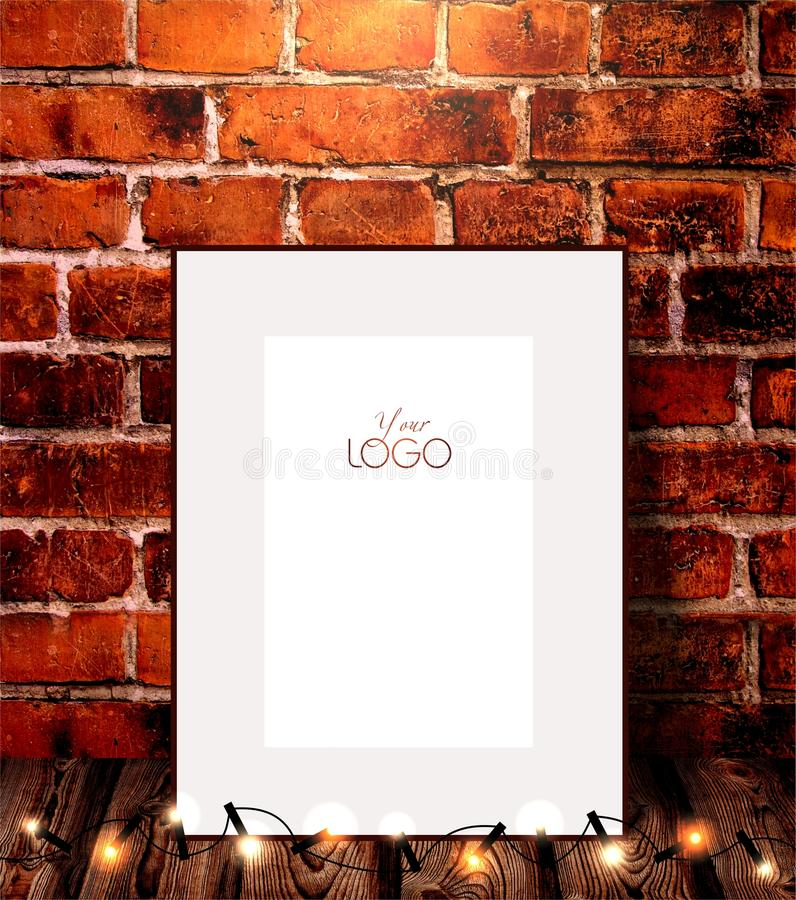 Wood frame and garland against a old brick wall. royalty free stock photography