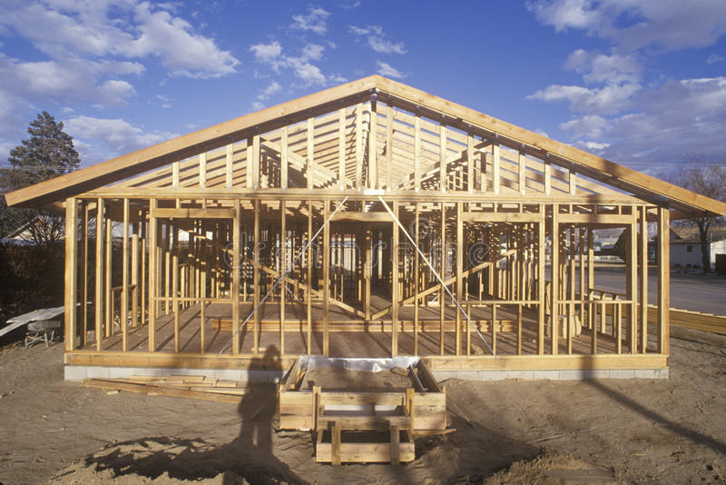 Wood frame of house under construction, Lone Pine, CA stock photo