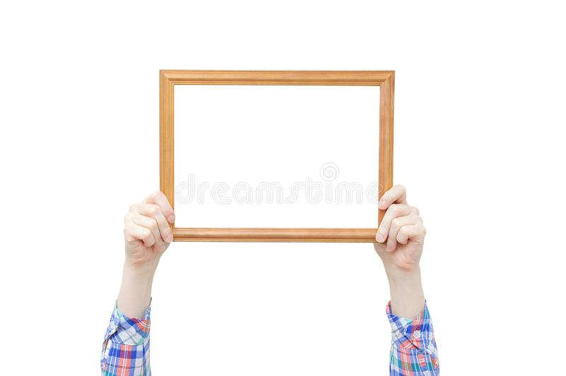 Wood frame for photo in the hands of a girl. Close-up. White isolate stock images