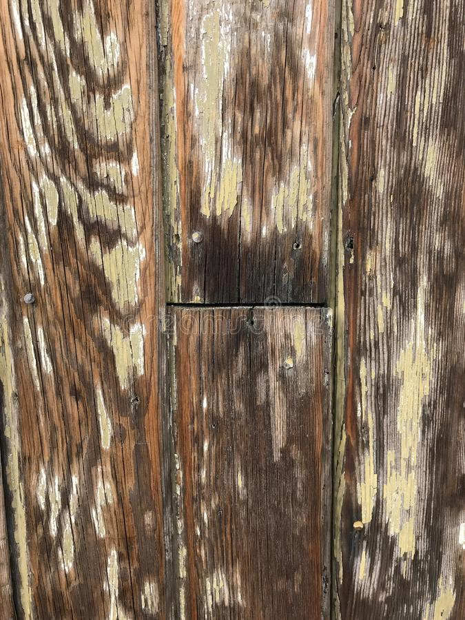 Wood grain planks with peeling paint stock images