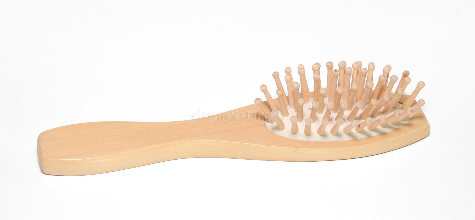 Wood Hair Brush. A wood hair brush against a white background royalty free stock images