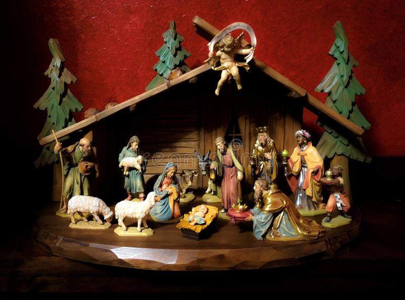 Beautiful Bavaria German Christmas Nativity Set with Jesus Christ in the manger Holy Family Angel Shepherd Magi Kings and animals. Wood Hand Carved Crèche stock image