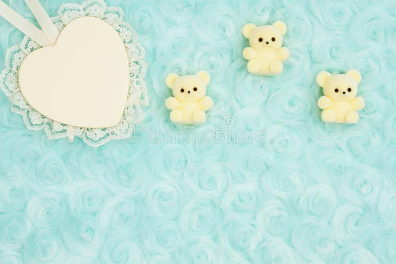 Wood heart with lace and teddy bears on pale teal rose plush fabric background stock photos