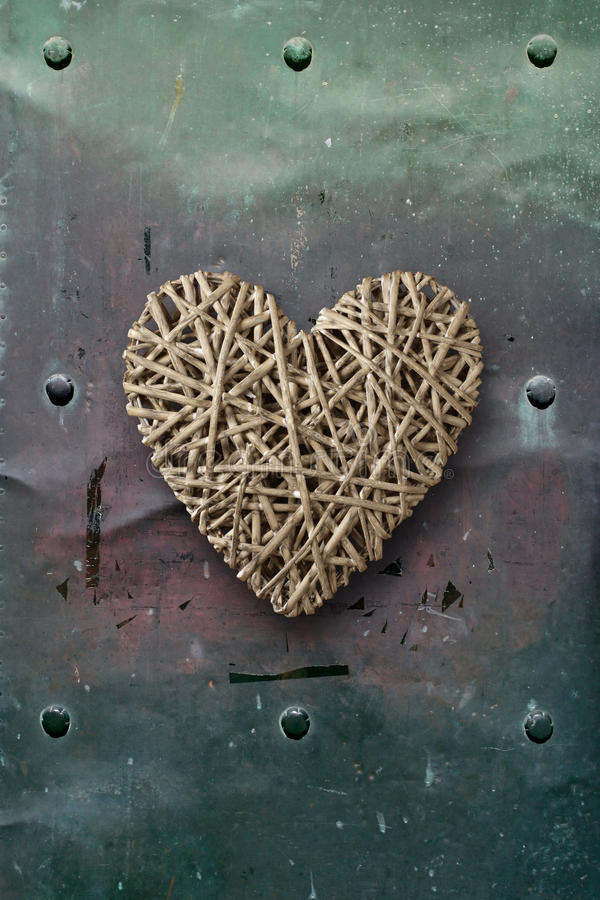 Wood heart on old metal background royalty free stock image