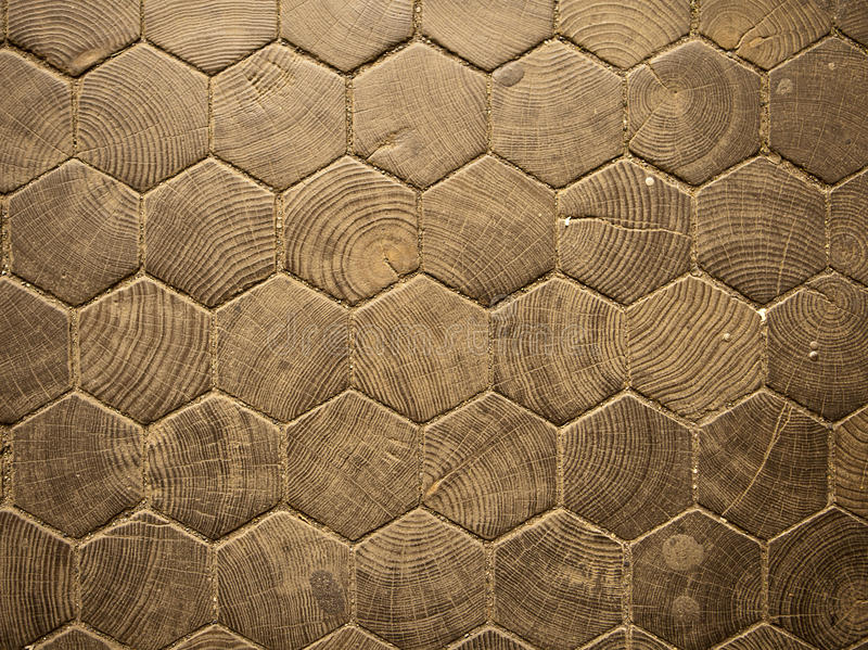 Wood Hexagon Pattern. The entrance hall to Trinity College in Dublin is paved with hexagonal wood blocks that form a geometric pattern in a parquet-like floor stock photography