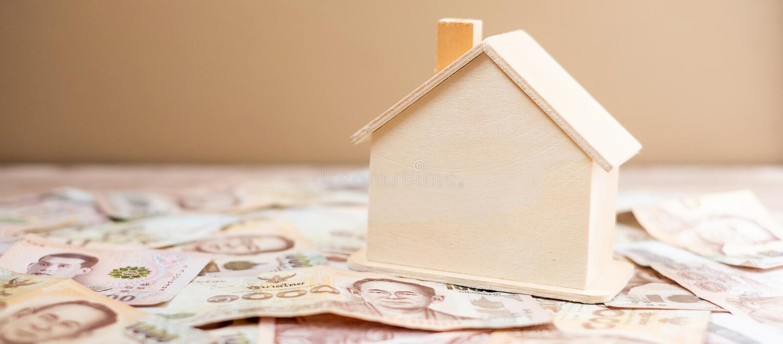 Wood house model, calculator and money , Thai baht banknote. real estate, Property investment, home mortgage financial and savings. Concepts royalty free stock photos