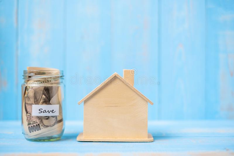 Wood house model and money glass jar, Japanese yen banknote. real estate, Property investment, home mortgage financial and savings. Concepts stock images