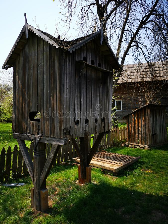 Wood house for pigeons in the yard. In the courtyard of an agricultural farm in a village stock photo