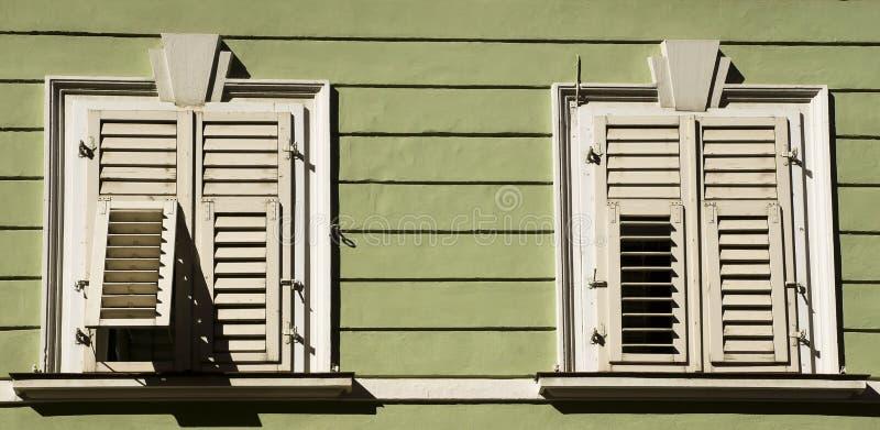 Wood house and shutters, Bolzano Italy royalty free stock photo