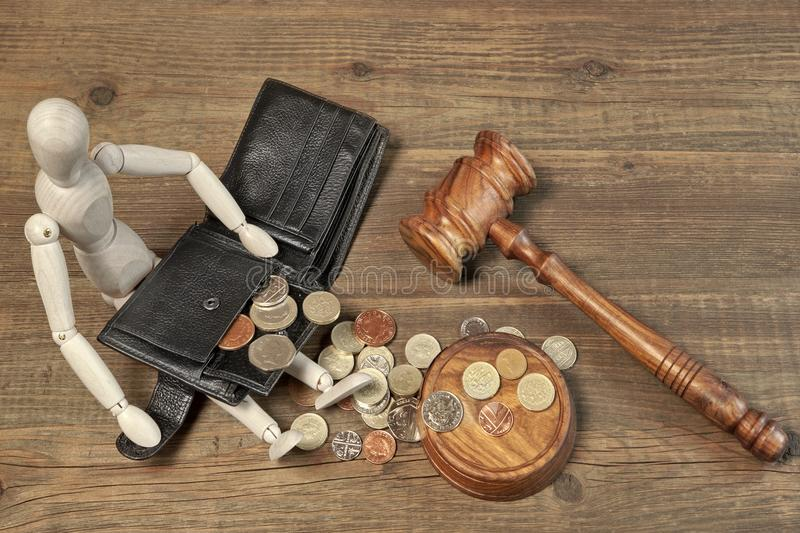 Wood Human Figurine, Black Wallet With British Coins And Gavel. Wood Human Figurine, Empty Black leather Male Wallet, Different British Coins And Judges Gavel on stock images