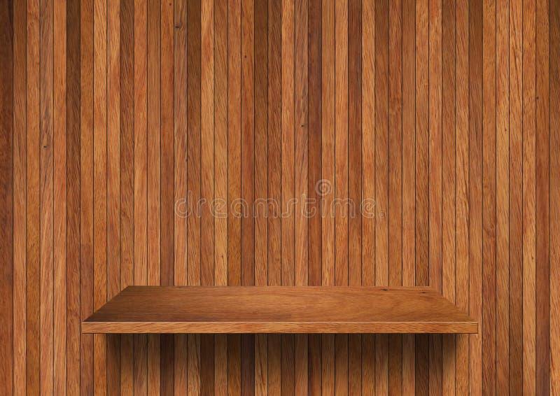 Wood hylla på den wood väggen royaltyfria bilder
