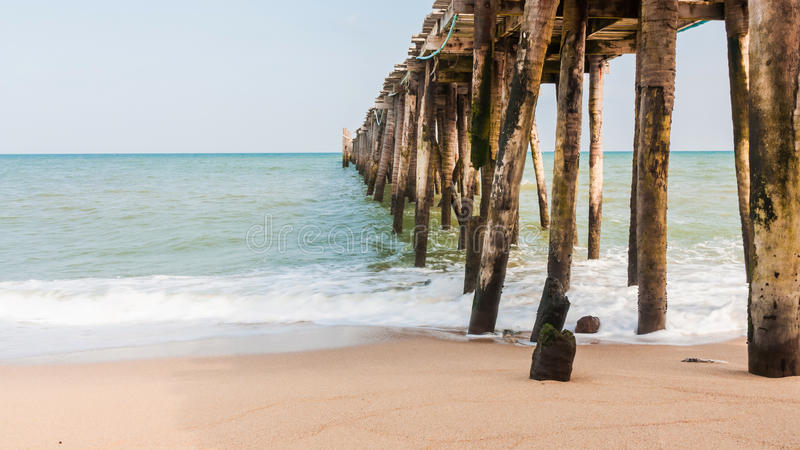 Wood jetty at beach. The old wood jetty at beach on daylight royalty free stock images