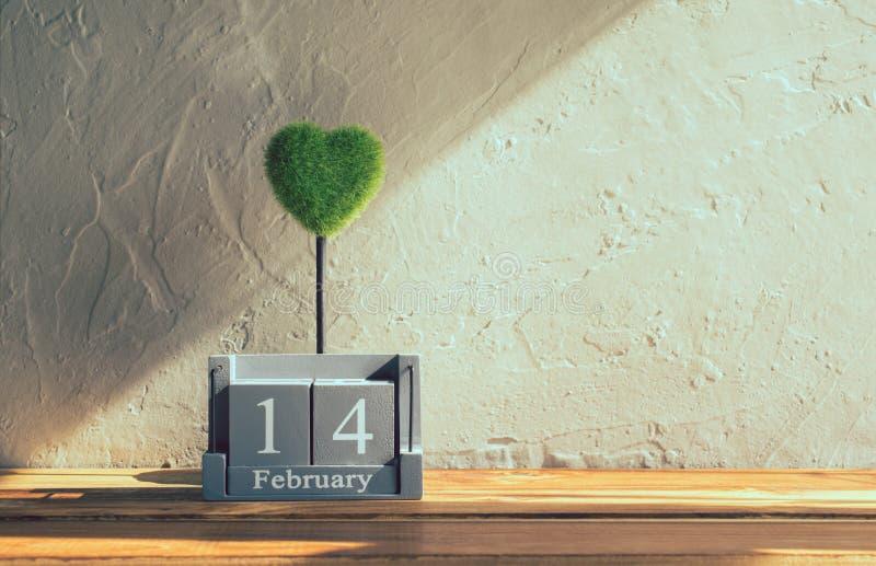 wood kalender för tappning för Februari 14 med grön hjärta på trä t arkivbilder