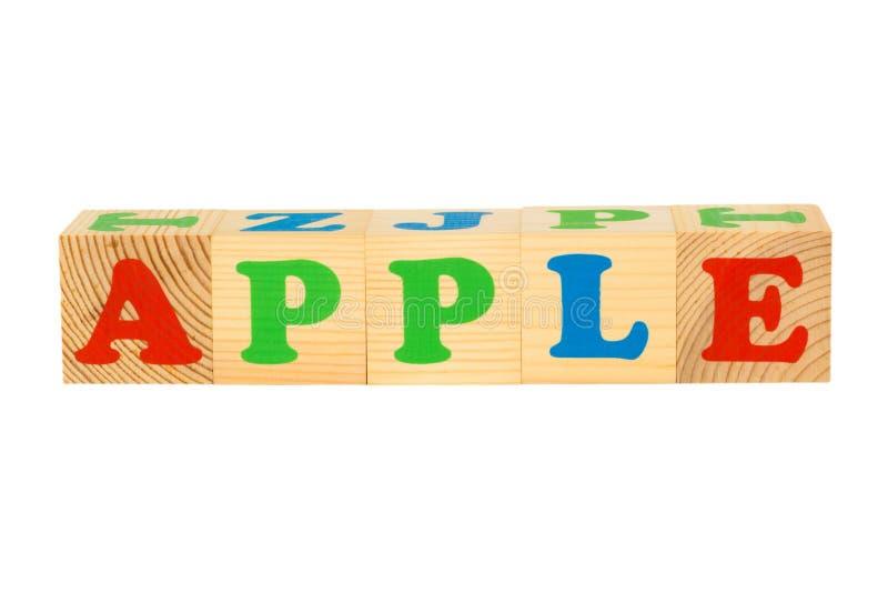 Wood kub med inskriften APPLE arkivbilder