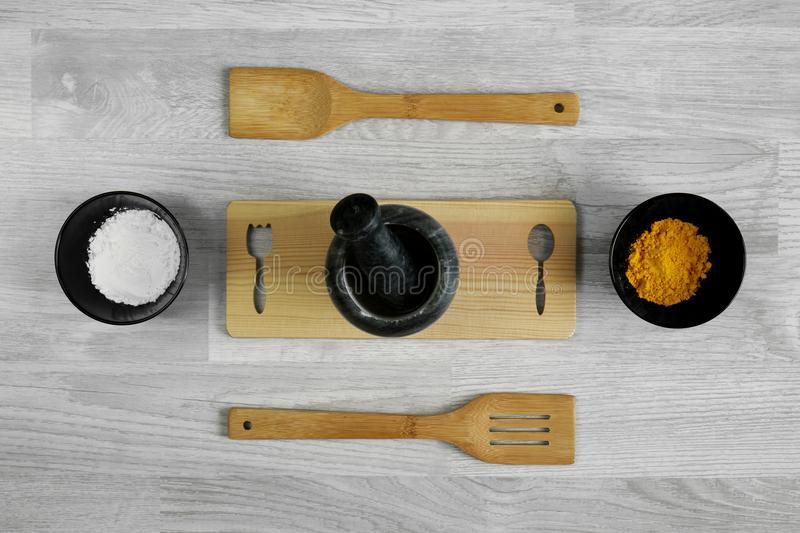 Wood ladle, mortar and spices on wood table background. royalty free stock photo