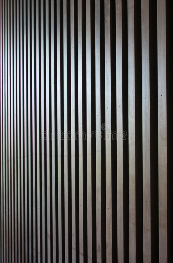 Wood lath wall. Dark wood lath wall background royalty free stock images