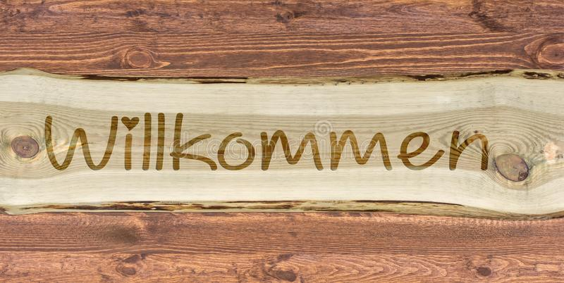 Wood lettering with the german word for welcome as an inscription royalty free stock photo