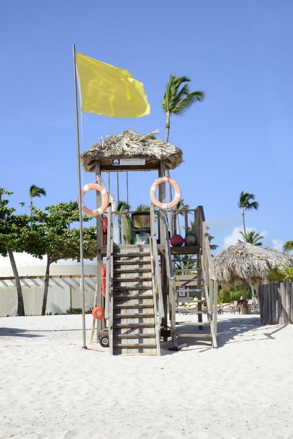 Wood lifeguard station on a white beach stock photos