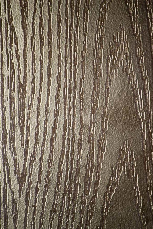 Wood-like finishing on a metallic entrance door. royalty free stock image