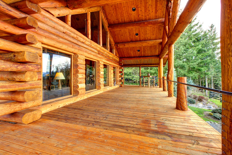 Wood log cabinet porch with entrance and bench. stock photo