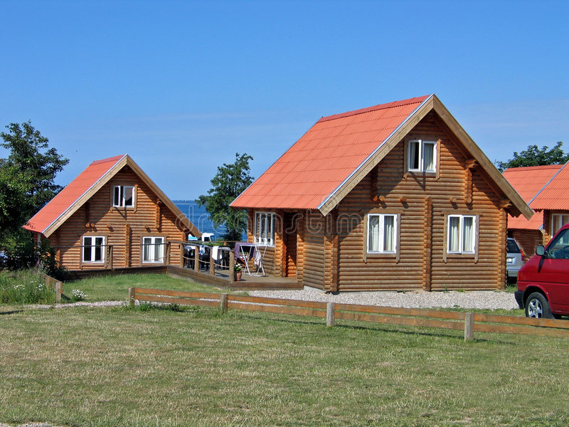 Wood logs summer house. Wood log homes summer houses in a vacation village stock photos