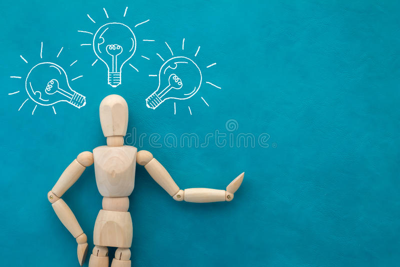 Wood man figure with light bulb creative concept royalty free illustration
