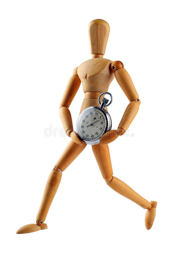 Wood man running with stop watch royalty free stock images