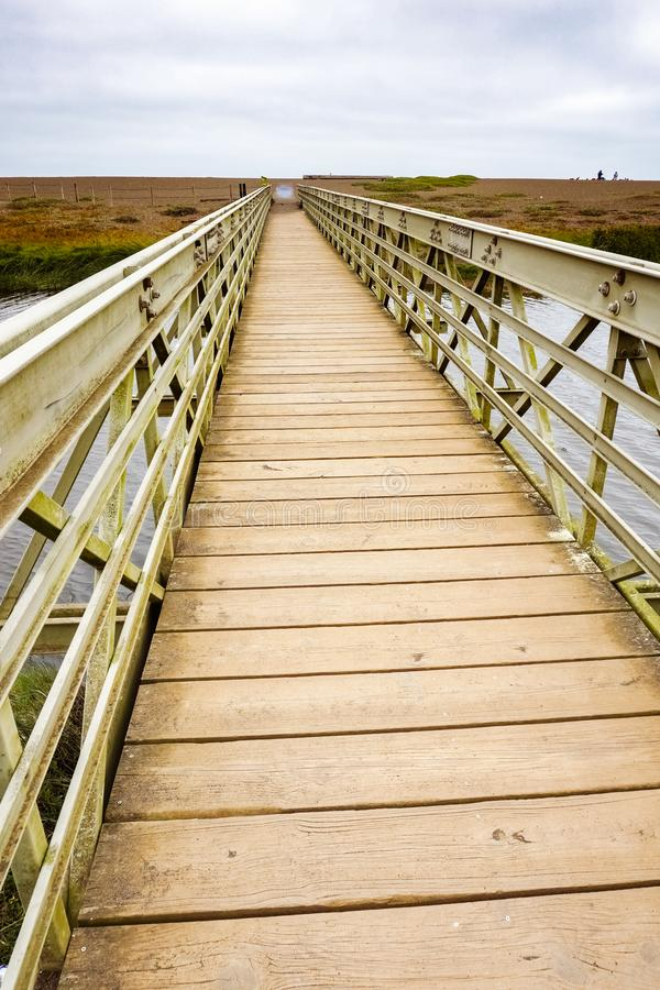 Wood and metal bridge crossing the Rodeo Lagoon towards Rodeo Beach, Headlands, Golden Gate Recreation Area, Marin County,. California royalty free stock images