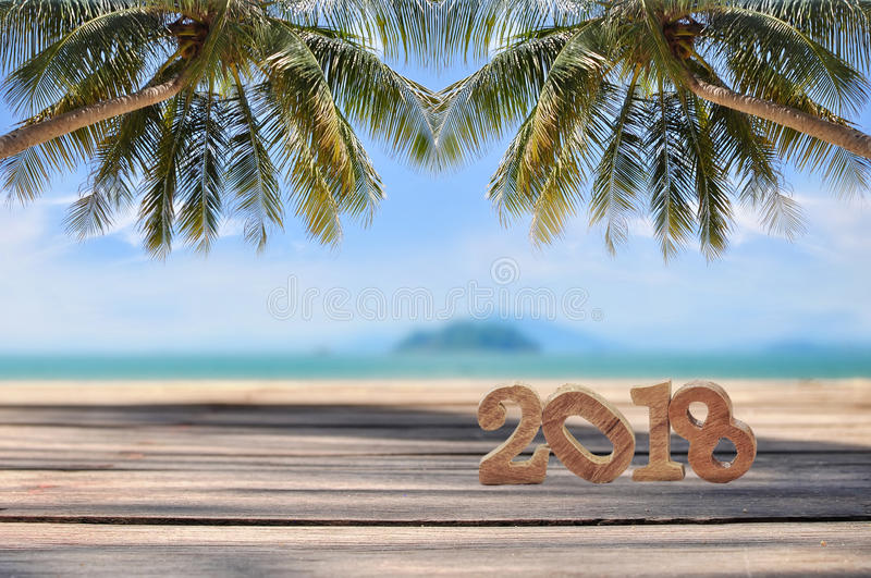 Wood Number 2018 On Planks On Tropical Beach Background Stock