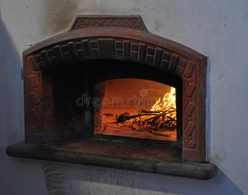 Traditional stone bread oven and open fire. Traditional bread oven. Open wood fire stock image