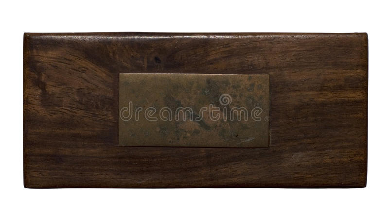Wood panel with aged brass plaque