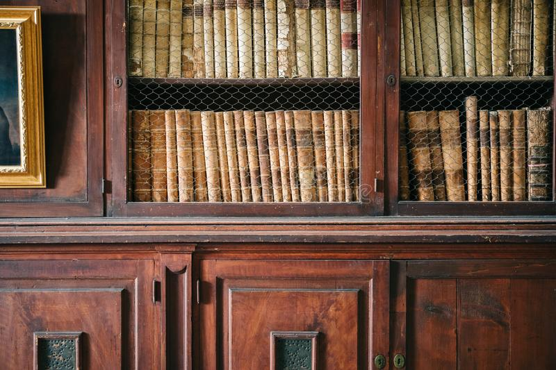 Wood panelled walls and shelves in a historic library. Detail shot royalty free stock image