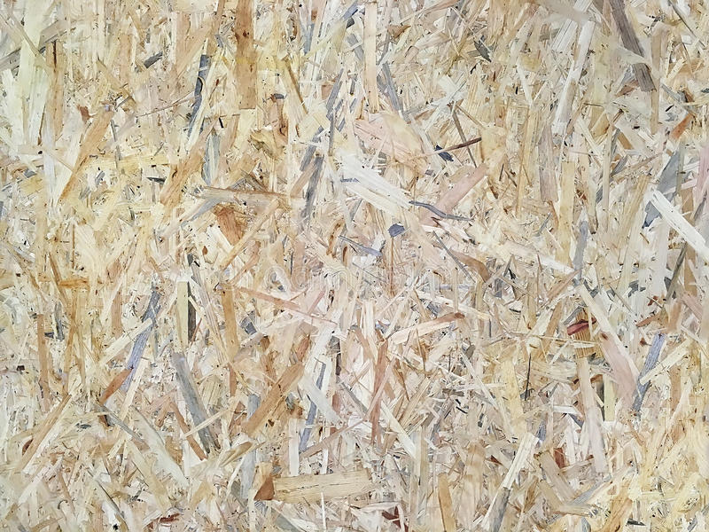 Wood panels made of pressed chips. Background - Oriented strand board OSB. Wood panels made of pressed chips closeup stock photography