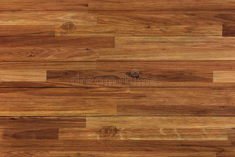 Wood parquet background, dark wooden floor texture. royalty free stock images