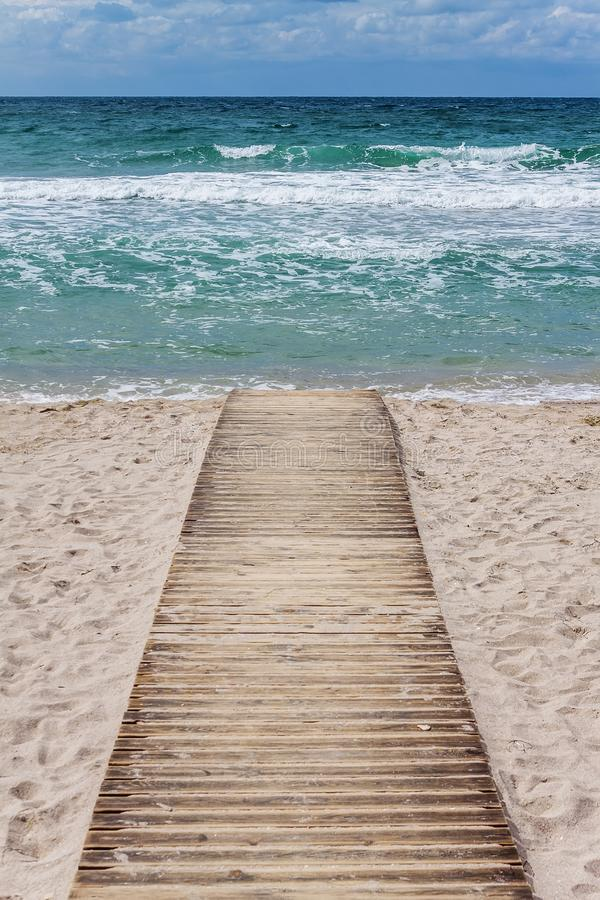 Wood path to the sea stock image