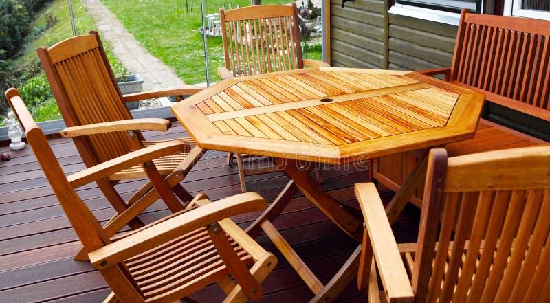 Wood patio furniture stock photos