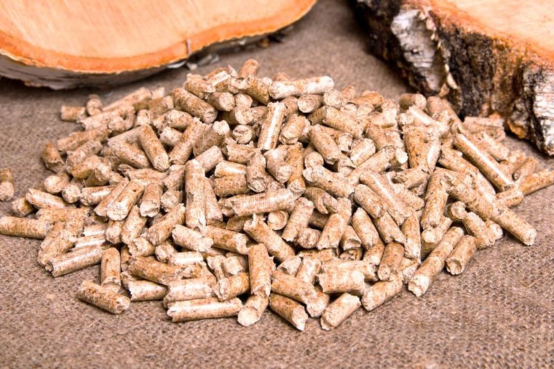 Wood pellets and birch close up .Wooden pallet biofuel. Biomass Pellets-cheap energy. The cat litter. Alternative, background, biological, burn, central, chip royalty free stock photography