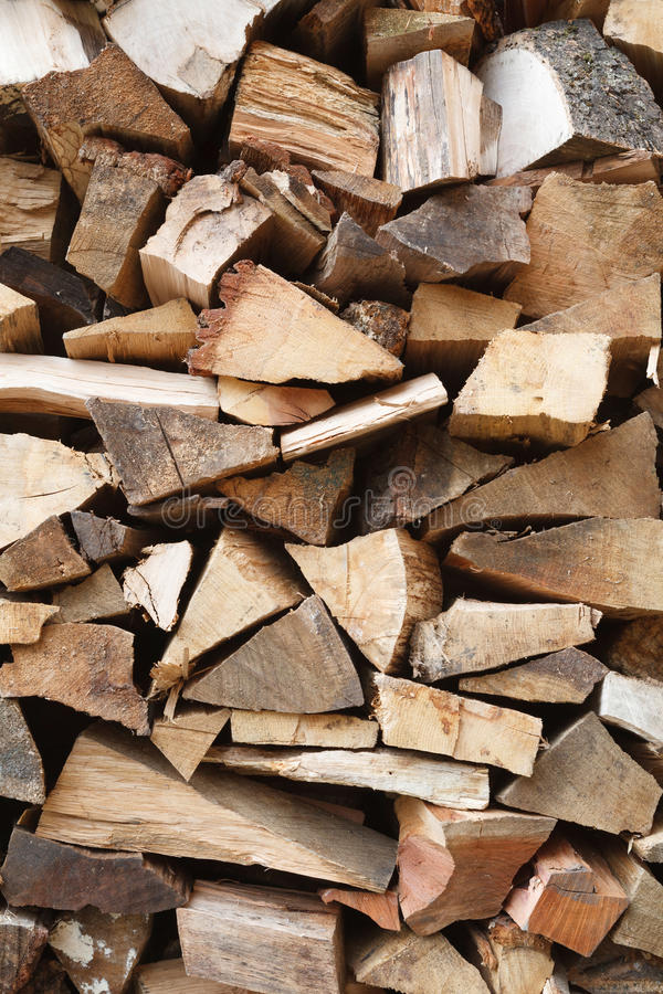 Wood pile. Closeup of sawn oak firewood stacked in a woodpile royalty free stock photo