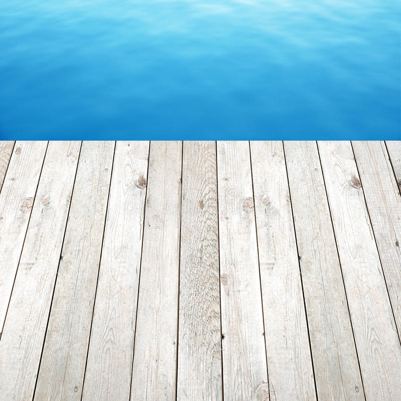 Wood Floor On Beach Sea And Blue Sky For Background Stock: Wood Plank As A Pier On Blue Sea & Sky Background Stock
