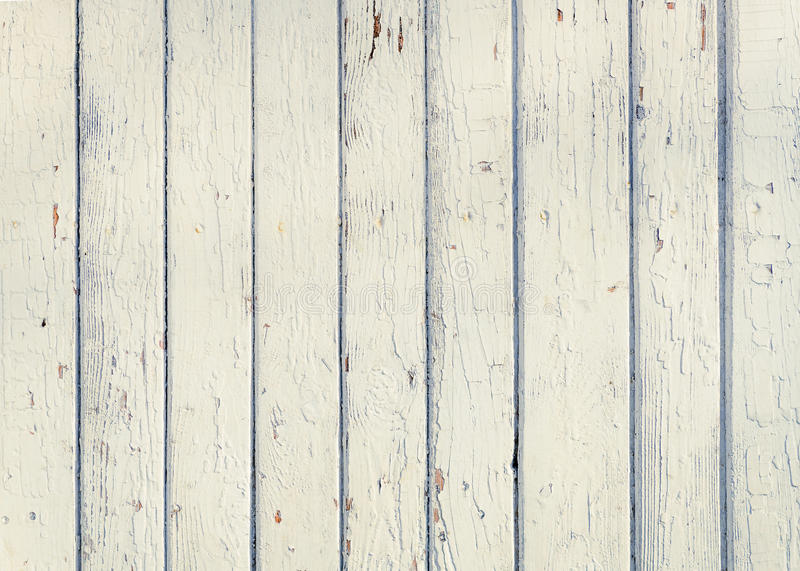 Wood plank fence with an old paint white color close up. Detailed background photo texture. Wooden wall abstract background. royalty free stock photos