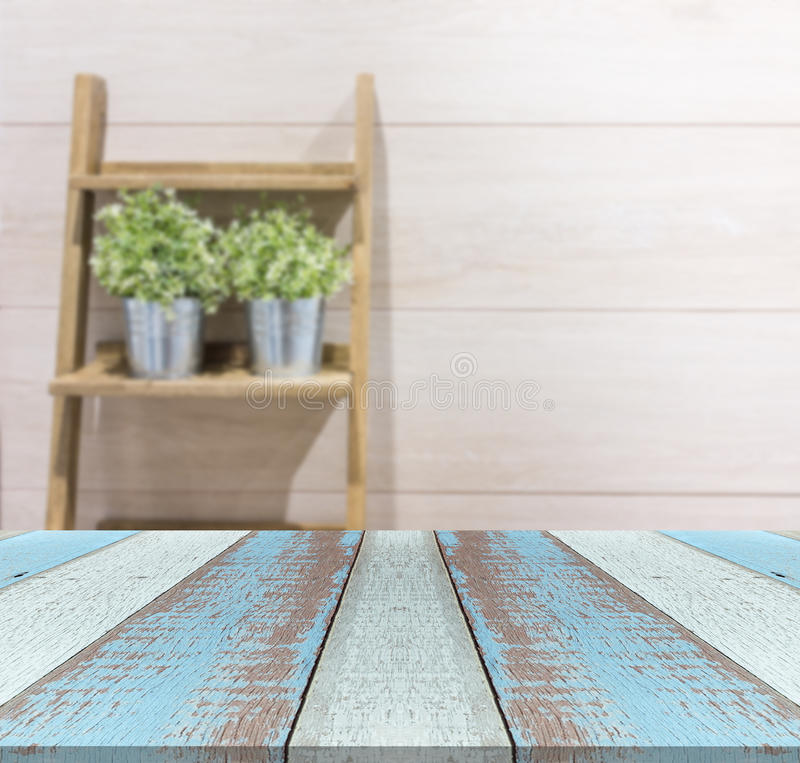 Wood plank or table top with flowerpot on the stair with wood laminate background. stock photography