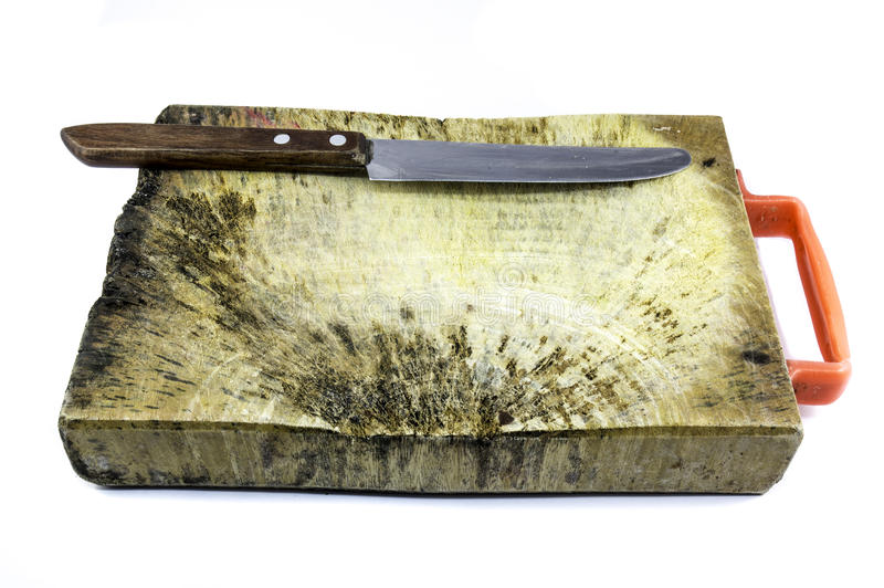 Wood plate (wood block) for cut ingredient and Peeling knife royalty free stock images