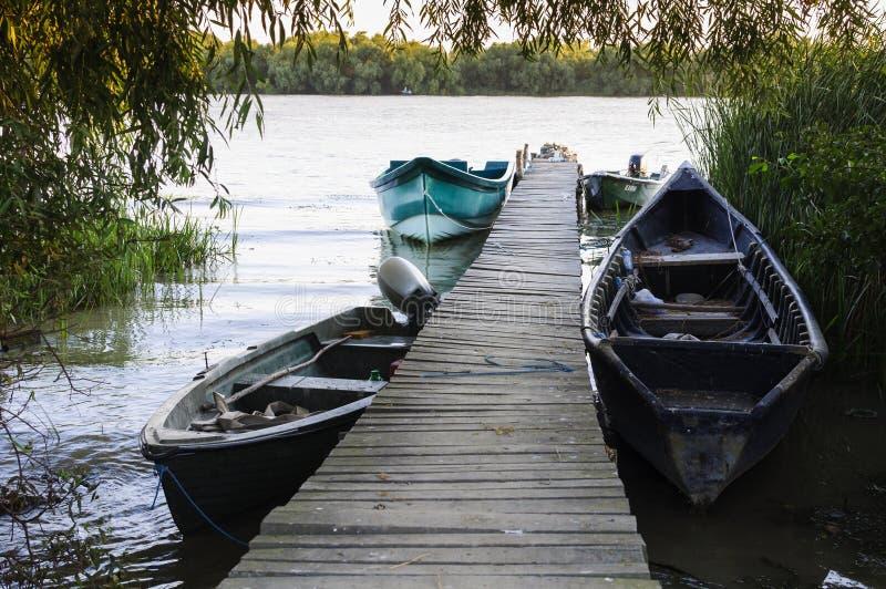 Wood pontoon and boats royalty free stock photo