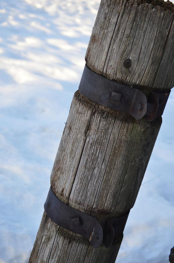 Wooden Post Sitting on Snow Bank stock photography